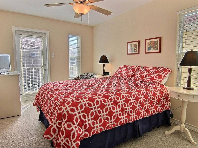 Bedroom 2, queen bed, TV and view of the pool