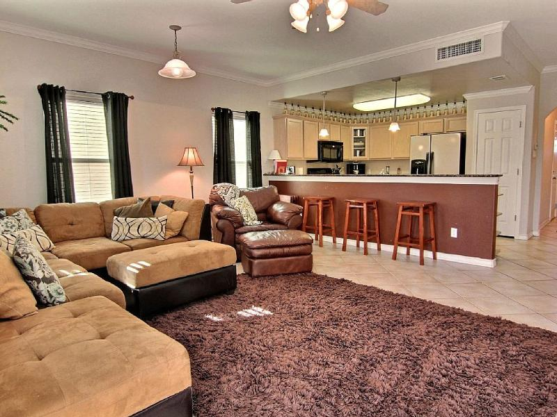 Living Dining Combo with  temperpedic sleeper sofa, 4 seat dining table and 3 seats at the bar.