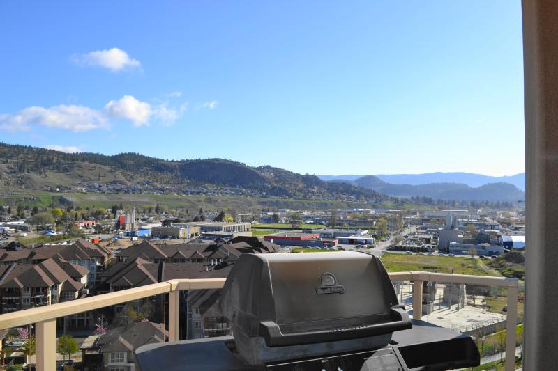 BBQ Deck view to the mountains and downtown and a peak at the lake from the side view