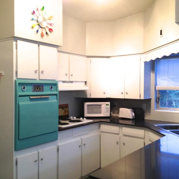 Newly remodeled bright kitchen with quartz countertops. Vintage oven!