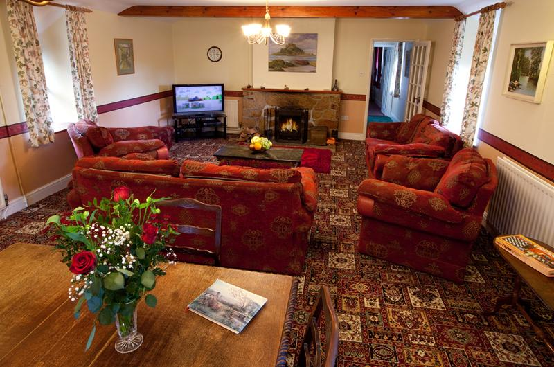 Spacious lounge, warm and cosy with balcony for sitting in sun. Open fire, full central heating