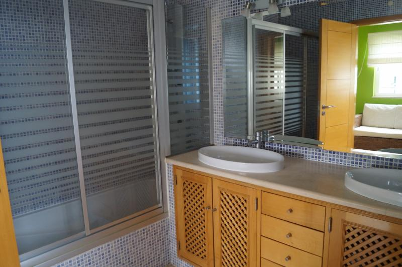 Master bedroom En-suite with basins, bath and shower
