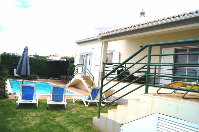Rear house, lawn and pool