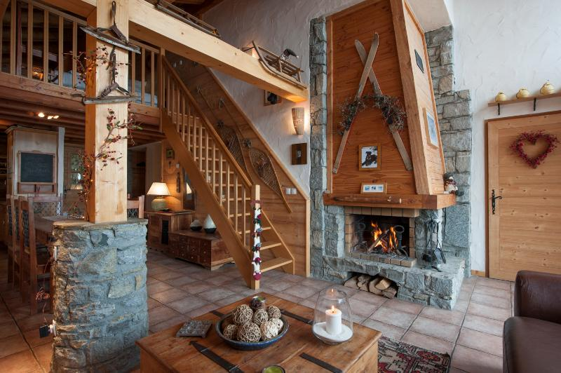 The lounge has a log fire, and upstairs is the open mezannine level bedroom.