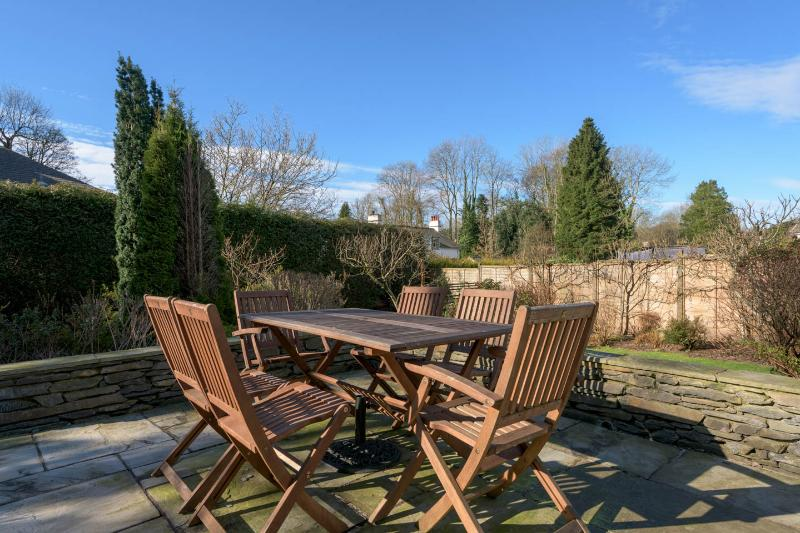 Sunny patio in well tended garden