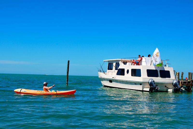 Your docked houseboat, kayaks included.
