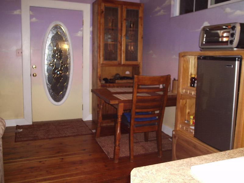 Front door kitchen, cupboard and table