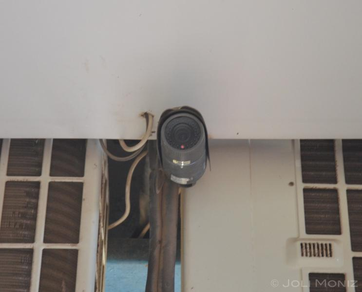 Security cameras monitoring the front of the building, controlled from supermarket on ground floor.