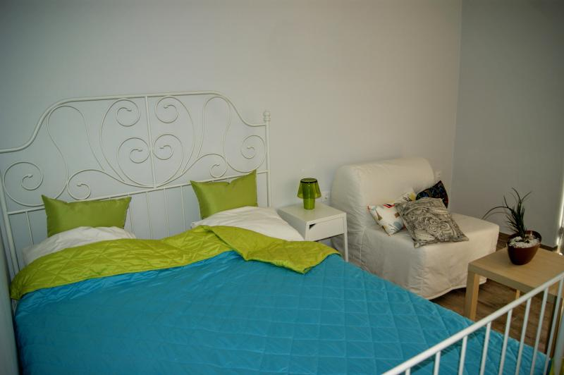 Queen bed and single sofa bed