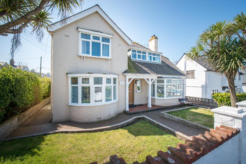 Spacious property with enclosed gardens just 75m from the beach!
