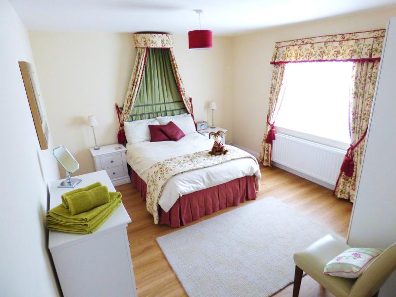The Master Bedroom has matching Canopy, curtains and throw as well as quality furniture.