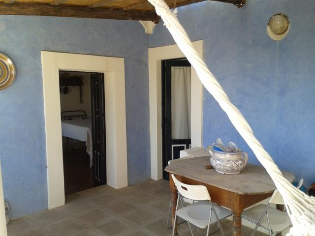 The terrace and the doors of a bedroom and bathroom