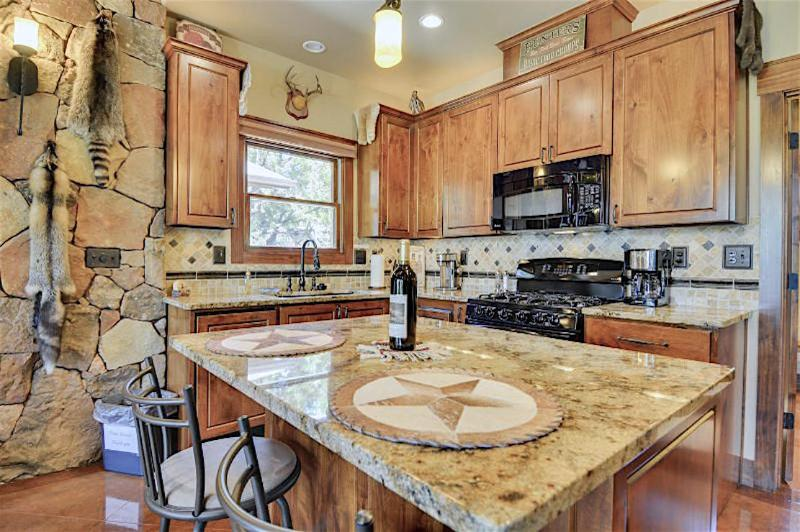 Polished granite countertops throughout the kitchen