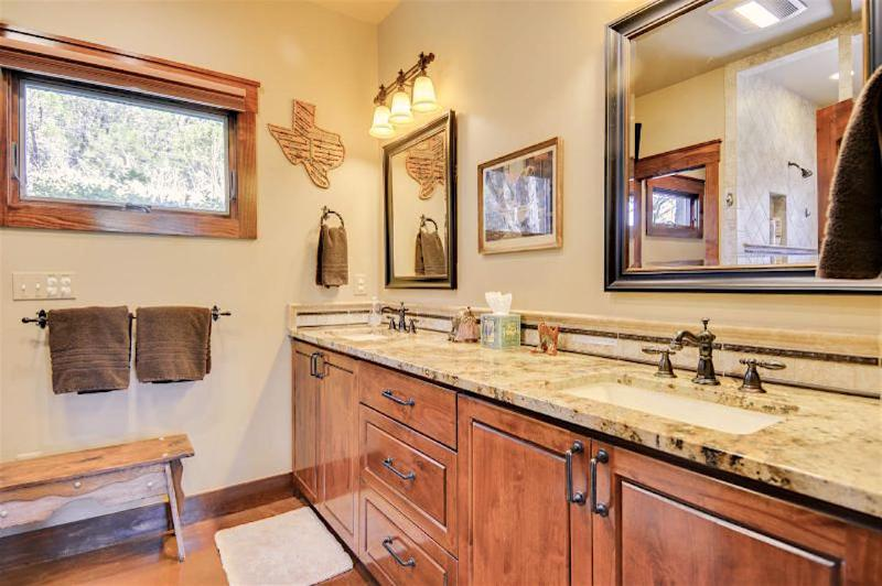 The bathroom counters and cabinets are custom. The walls are decorated vintage Texas hill country