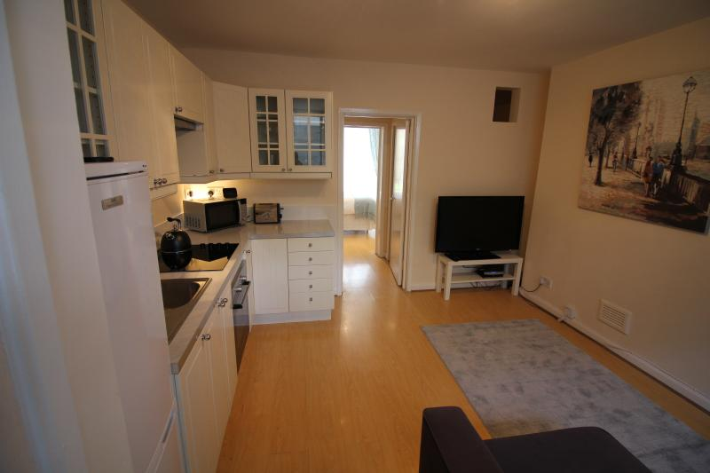 Kitchen, looking through to the bedroom and garden