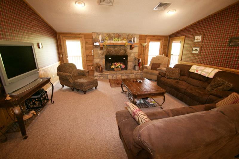 Watch the game or relax in front of the wood-burning fireplace with family and friends