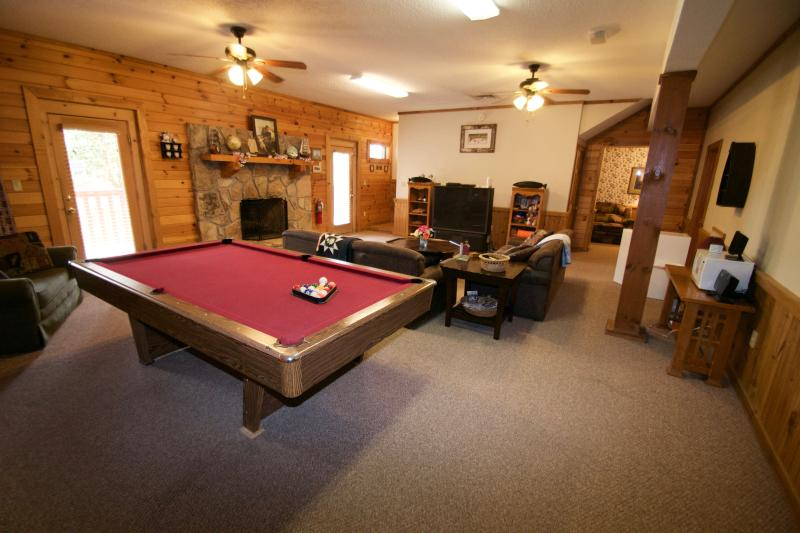 Play pool or watch tv in the downstairs Den w 2 couches, wood-burning fireplace, and snack station