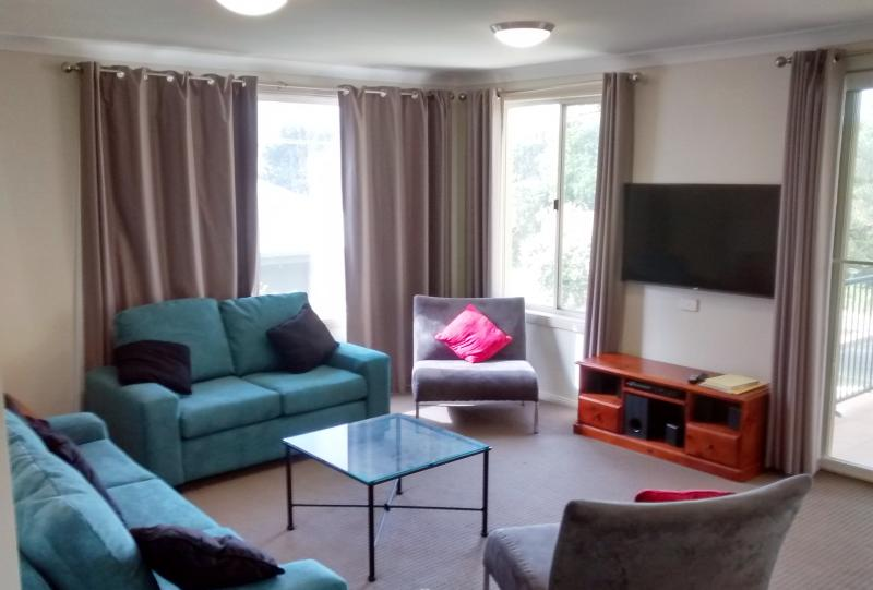 Lounge room with seating for 7, large screen TV. DVD player with surround sound provide