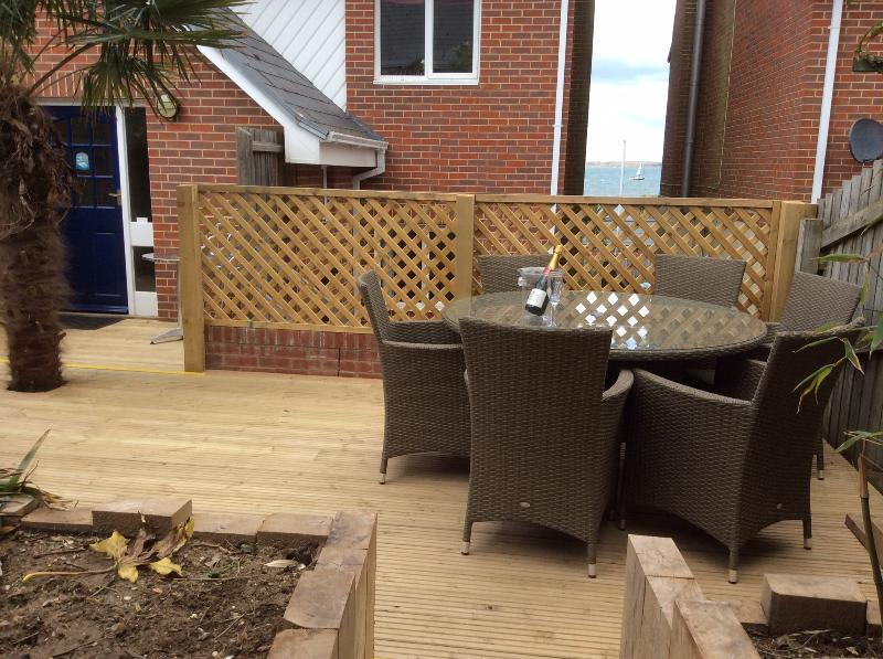 Sun drenched patio area with outside eating