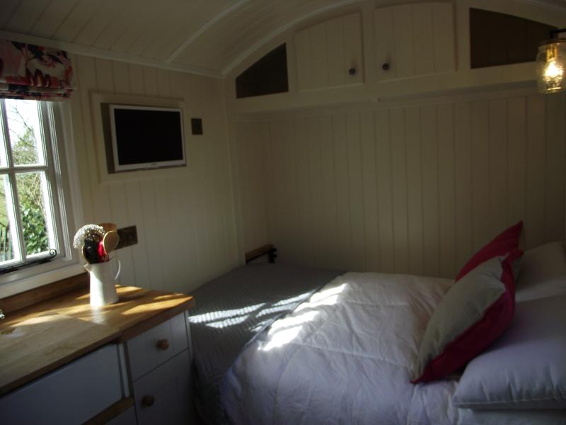 Double bed, already made, folds down from the wall