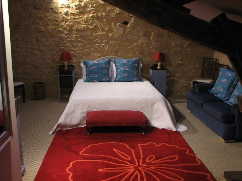 """The Enormous Master Bedroom Suite with beautiful beams and walls """"en Pierre Apparante&q"""