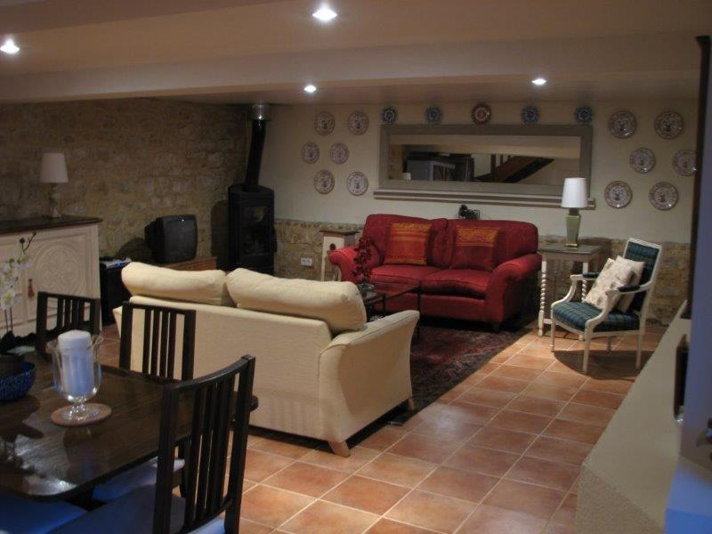 The Enormous Living Area with 2 Comfortable Sofas, French Chair, Satellite TV and Woodburning Stove