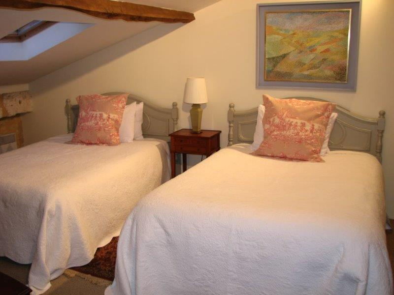The Second Bedroom with Crisp White Bedding and Antique Headboards.