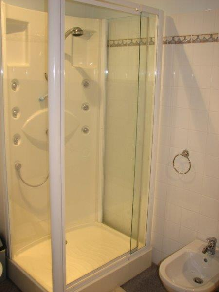 """The Ensuite Master Bathroom with """"Spa Shower"""" - there is a full sized bath too!"""