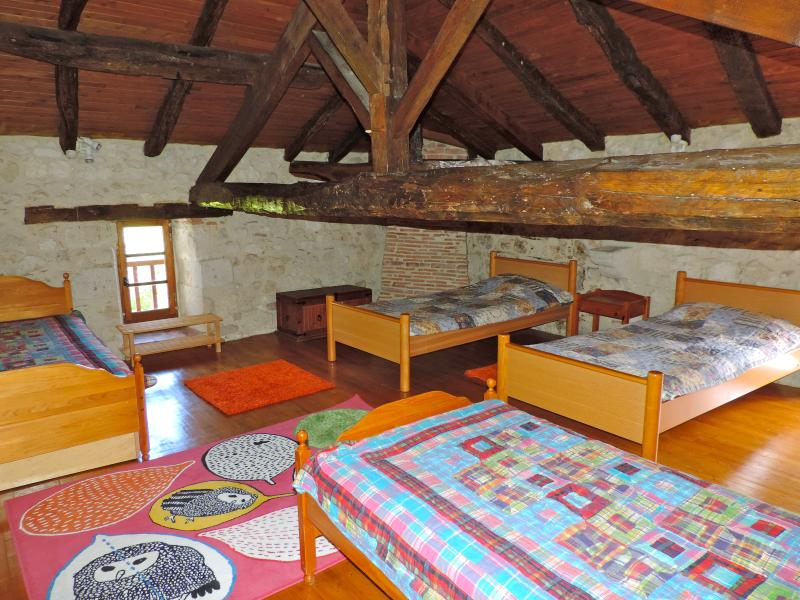 Upstairs, a room with 4 single beds