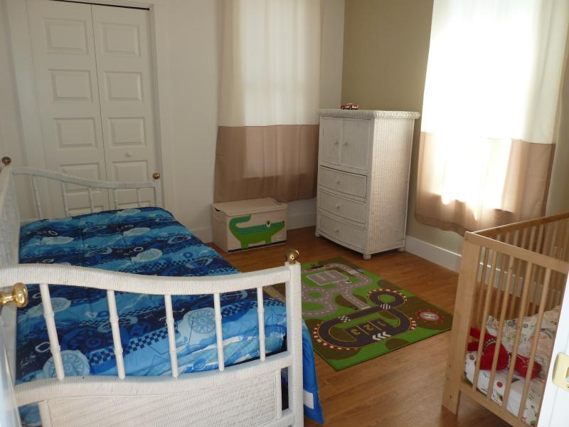 2nd bedroom with large crib, trundle bed for extra sleep space. Baby monitor gizmo included.