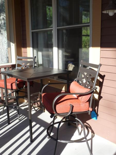 screened in porch is great for morning coffee or evening wine