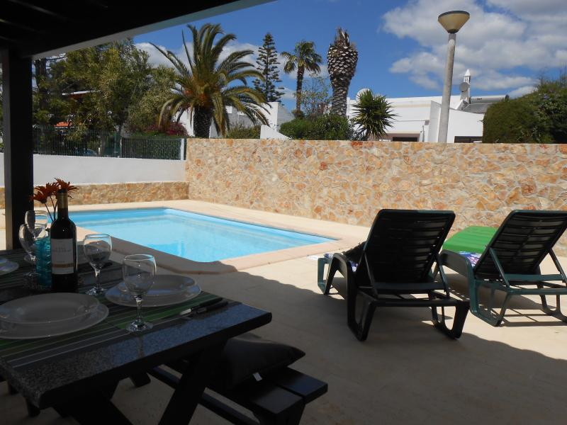 Private swimming pool and shaded dinning area.