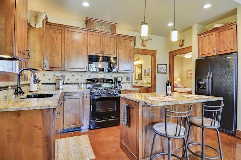 The Cottage has a complete kitchen with island, gorgeous woodwork, granite, and excellent lighting