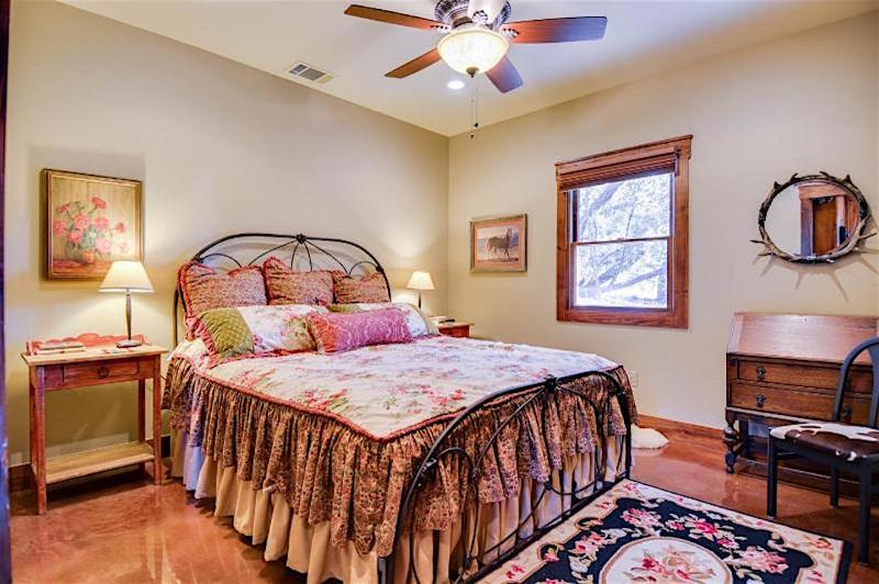 Decorated and comfortable, the Cottage main bedroom has a California King size bed, desk and closet