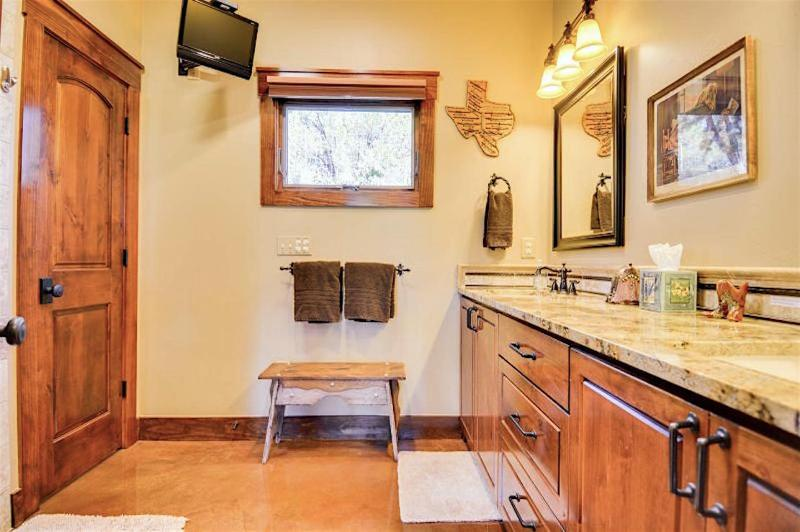 The Storybook Cottage boasts a spacious and immaculate 2 sink bathroom with granite counters