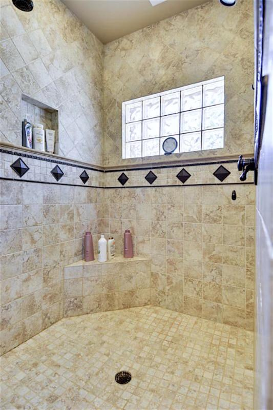 Cottage guests enjoy the spacious open shower with opaque window and natural light