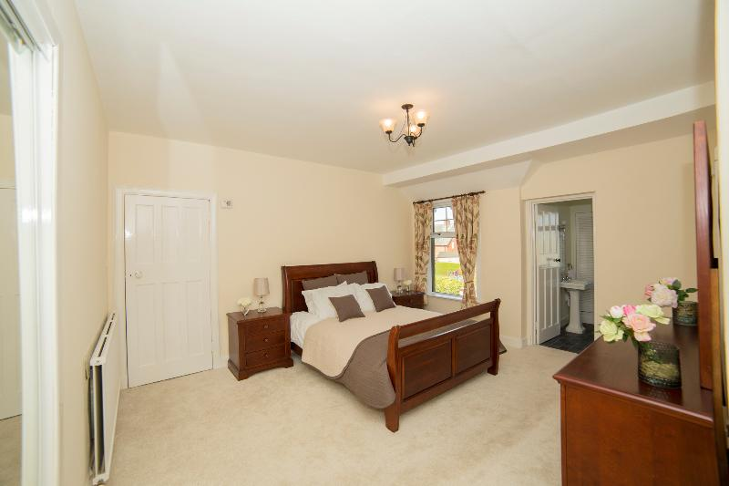 Master bedrrom with king size bed and ensuite