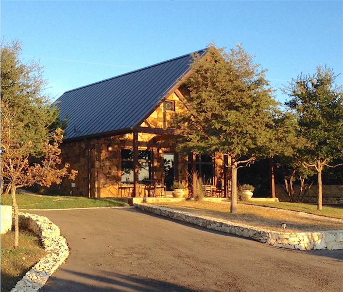 Cottage guests enjoy a Chateau exterior, stone landscaping, open spaces, and private parking