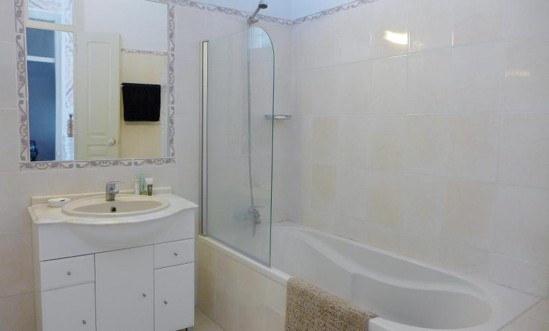 Spacious family bathroom with bath and shower