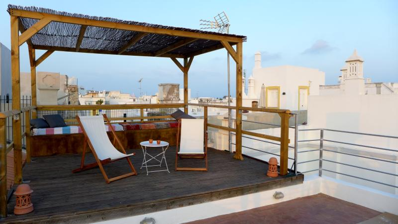 Spacious roof terrace with sea views, perfect for sunbathing or watching  beautiful sunsets