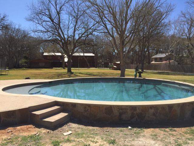 Solar-heated swimming pool