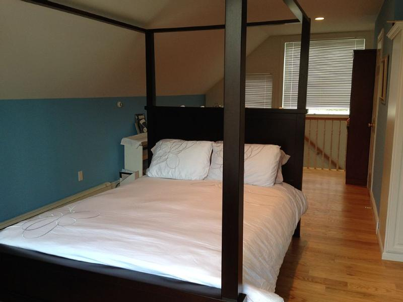 5th guest room, Queen bed, ensuite bathroom, huge windows, spacious.