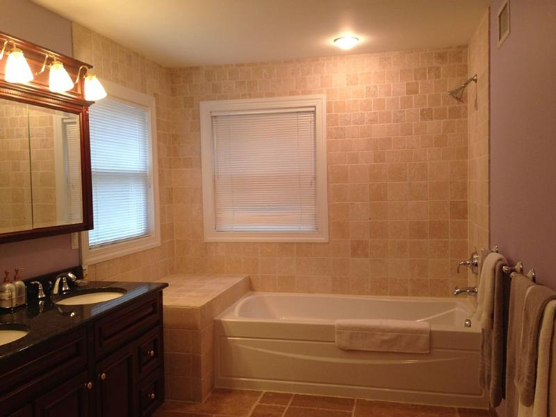 1st Floor Master ensuite bathroom, walk in shower (rainshower head) and bathtub