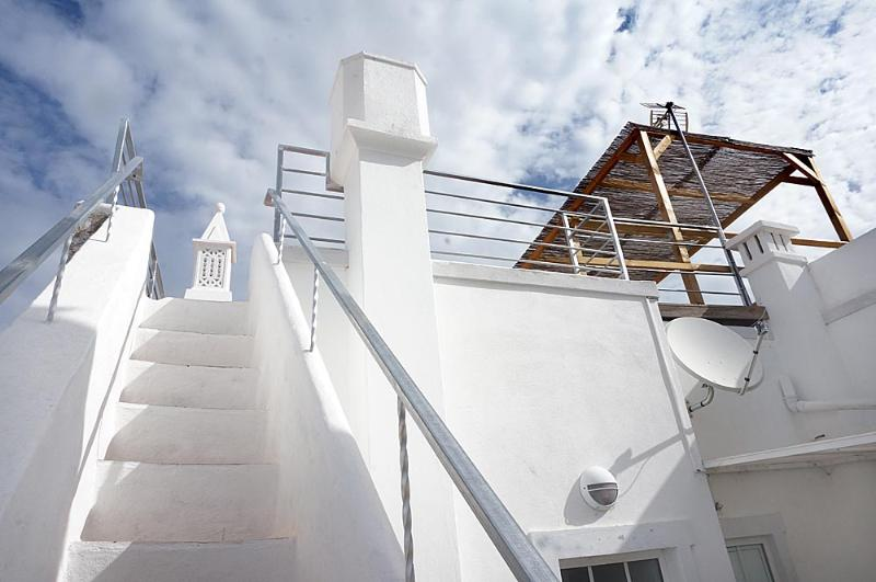 Stairs leading to roof terrace