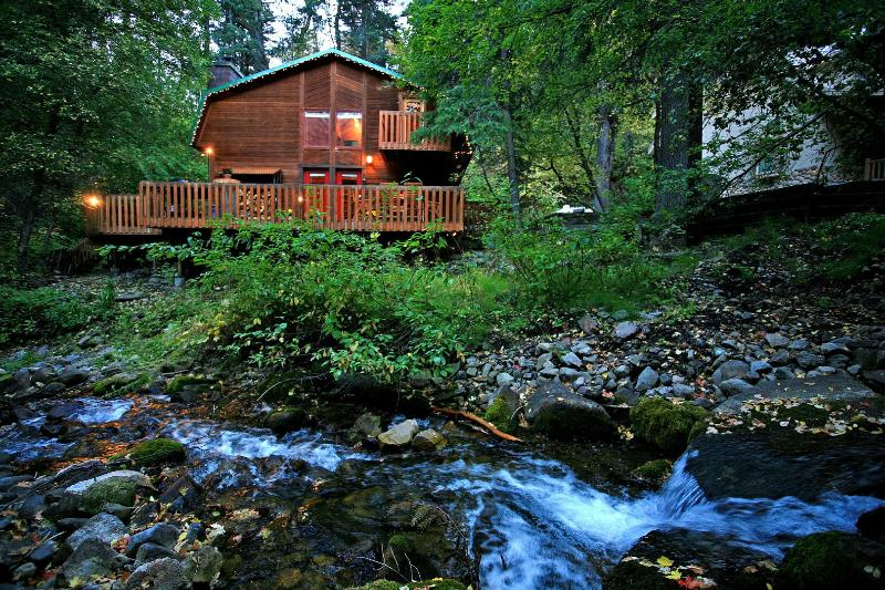 Enjoy this cabin tucked away stream side at the end of a private lane.