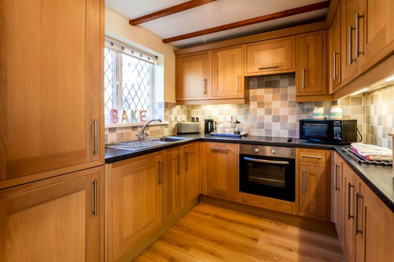 New wooden kitchen with all the appliances and equipment you're likely to need!