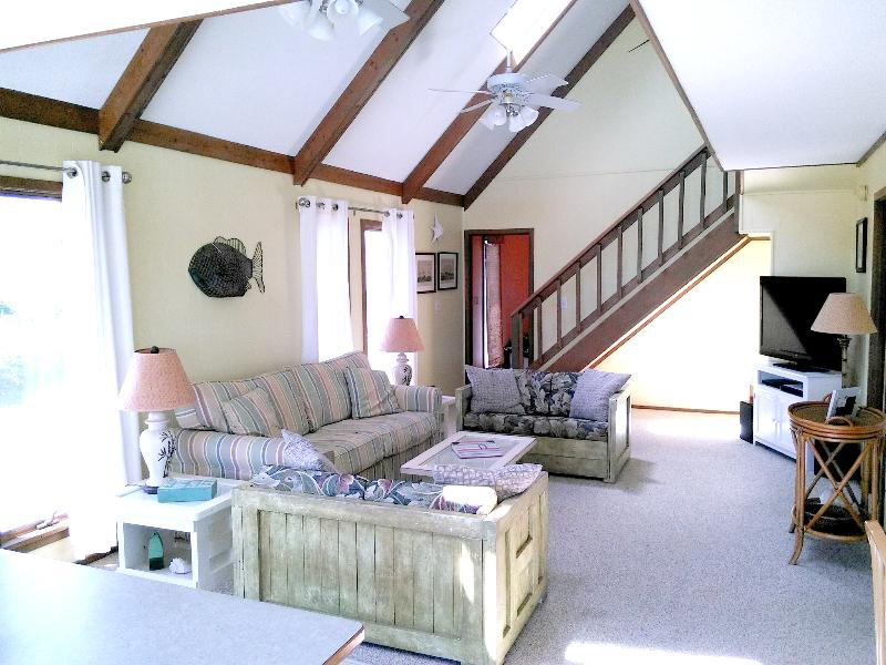Open & airy family room, enjoy our DVD library