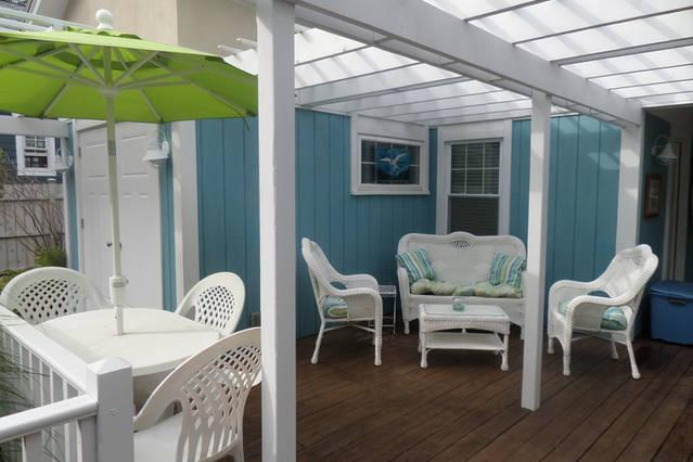 Dining area for 4 under the  umbrella.