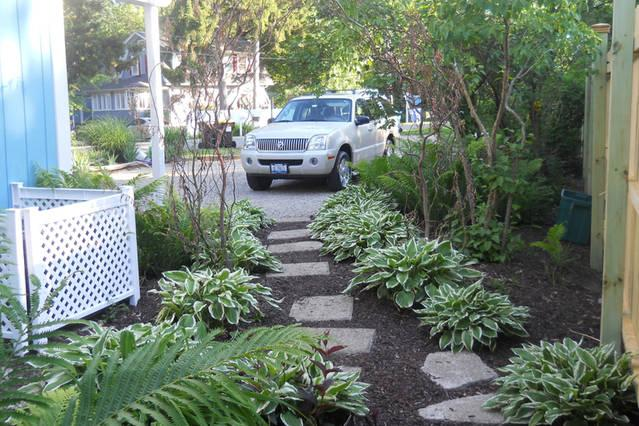 Shade garden off the back of the house and 2nd bedroom. A path that leads to drive way.