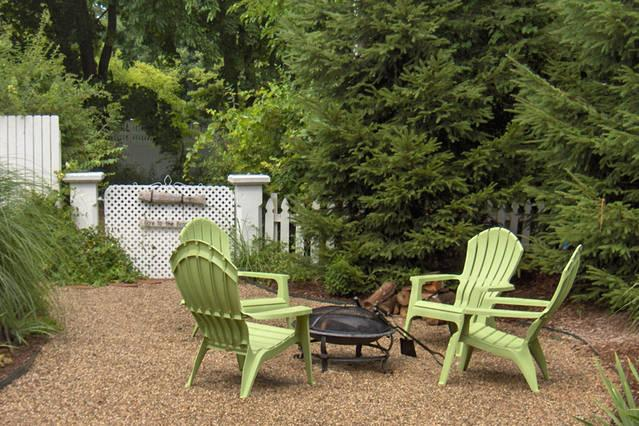 Fire pit nestled in pines and beach grasses on front patio. The garden gate opens to beach path.